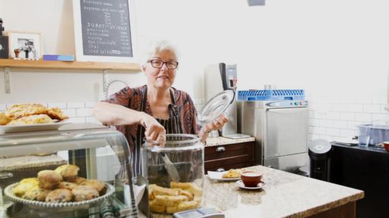 older worker in coffee shop