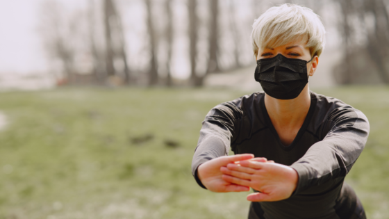 Woman exercising with mask